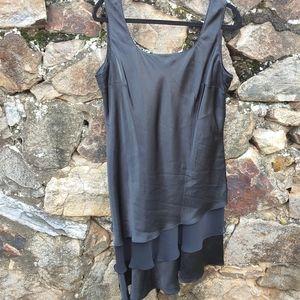 Karin Stevens Black ruffled tier dress angled hem